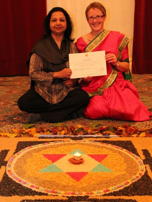 Sarah Waterfield receiving her Vedic Chant teaching certificate from Radha Sundararajan, October 2013, Park Place, UK. Photo by Li Backstrom
